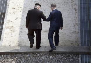 After the handshake the two men stepped back into North Korea