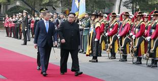 Leaders of both Koreas take to the red carpet