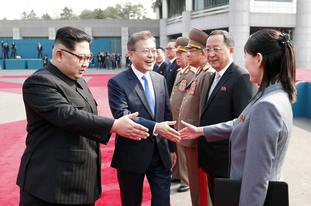 Mr Moon also shook hands with Mr Kim's sister Kim Yo Jong, who was part of the delegation from the north