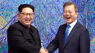 North Korean leader Kim Jong Un shakes hands with South Korean president Moon Jae In.