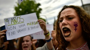 A woman shouts slogans in front of the Regional Court .