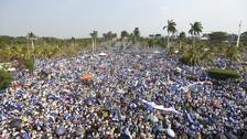 Thousands of people congregate outside Managua's Cathedral during a massive march in Managua.