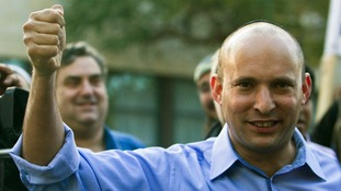 Naftali Bennett, leader of the Bayit Yehudi party, gestures after casting his vote