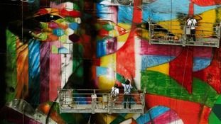 Brazilian graffiti artist Kobra puts the final touches to his mural