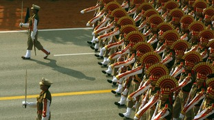 Indian soldiers march during the full dress rehearsal for the Republic Day parade in New Delhi