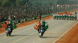 Indian soldiers perform a dare-devil show on their motorcycles