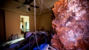 The damaged bedroom of the couple's property in Utah