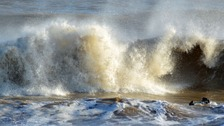 Heavy rain and strong winds are forecast for the Anglia region which could lead to large waves and potential flooding.
