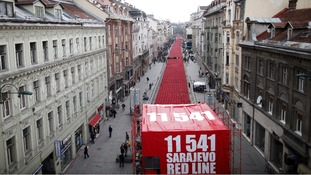 11,541 red chairs are pictured along Titova street in Sarajevo