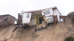Four more clifftop homes need to be demolished after two metres of coastline was washed away at Hemsby, Norfolk.