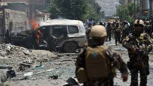 Smoke and flames rise from burning vehicles at the site of a bomb blast that targeted NATO forces in Kabul on July 7, 2015.