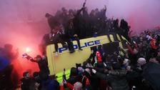 Fans on top of a police van before the Uefa Champions League semi-final first leg in Liverpool.