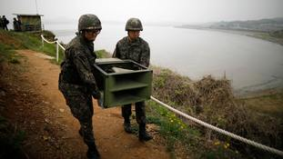 South Korean soldiers move loudspeakers near the demilitarised zone in Paju.