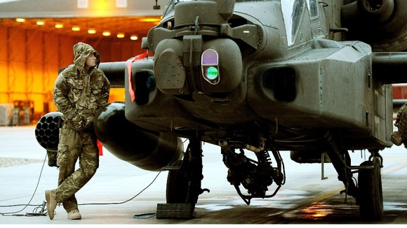 Captain Wales seen in December 2012 making early morning pre-flight checks at Camp Bastion