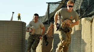 Prince Harry seen in November 2012 racing off on another mission in Afghanistan