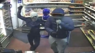 Quick-thinking shopkeeper fights off masked armed robbers by spraying them with WD-40