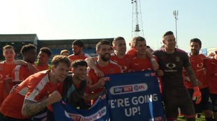 Luton celebrate promotion to League One.