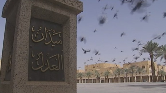 Birds fly over Justice Square, Saudi Arabia