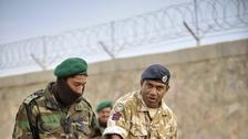 British soldiers and interpreters teaching Afghan National Army soldiers