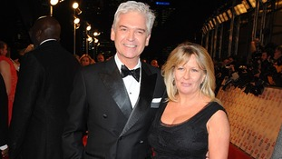 Phillip Schofield and wife Stephanie arriving for the 2013 National Television Awards at the O2 Arena