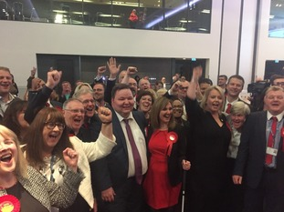 Labour councillors in Trafford celebrate as the Conservatives lose overall control of the council.