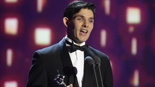 Coin Morgan accepts the award for Best Male Drama Performance for Merlin during the 2013 National Television Awards at the O2 Arena