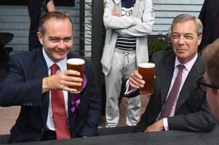 Mr Oakley enjoying a beer with Nigel Farage in 2017.