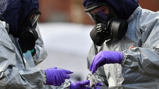 Police bagging swabs where former Russian double agent Sergei Skripal was found critically ill.