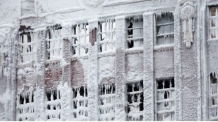 Firefighters battled with ice covered ladders and freezing hoses