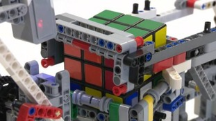 College student builds a Rubik's cube-solving robot