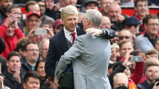Sir Alex Ferguson presents old-foe Arsene Wenger with a gift marking his departure from Arsenal.