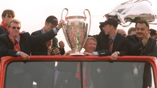 Ferguson celebrating with the famous 'Treble' winning Manchester United team in 1999.