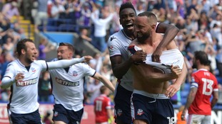 Bolton strike late on to stay in the Championship at the expense of Burton Albion and Barnsley