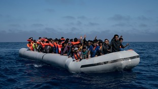 An overcrowded rubber boat rescued north of the Libyan coast on Sunday.
