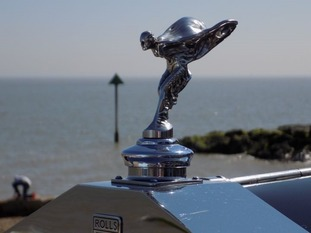 A Rolls Royce 'Spirit of Ecstasy' figure enjoying the glorious sunshine on Felixstowe seafront taking part in the Ipswich to Felixstowe Historic Vehicle Road Run on Sunday 6 May 2018.