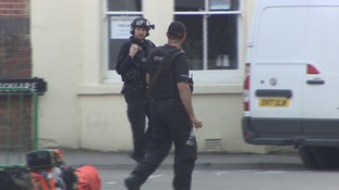 Armed police and gunman in shooting standoff ''ended peacefully''