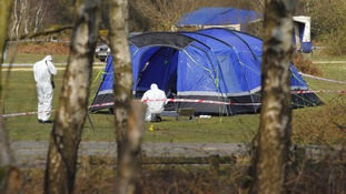Police remain at the scene of the campsite in Bransgore, Hampshire.