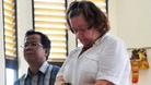 Lindsay Sandiford, with her translator, listens to the judge during a trial in Denpasar in Bali