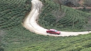 Going nowhere fast Mustafa Mert drives backwards up a hill