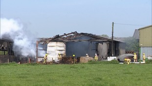 A fire that tore through a large farm building in Suffolk has been brought under control.