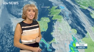 Emma Jesson in front of UK satellite weather graphic