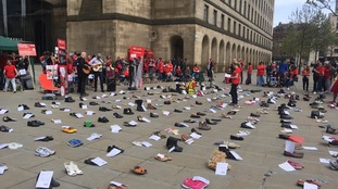 Empty shoes laid out  in St. Peter's Square