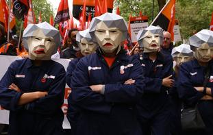 People dressed as Theresa May Bots during the TUC rally.