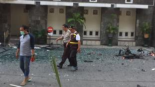 Family of six kill at least 13 in three suicide bomb attacks on churches in Indonesia