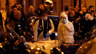 Scientific police officers investigate after a knife attack in central Paris.