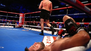 Sam Sexton (centre) on the floor during the Heavyweight title contest