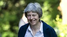 Theresa May holds telephone talks with Iranian president.
