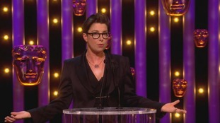 Host Sue Perkins tickles the crowd during a tense BAFTA Awards night.