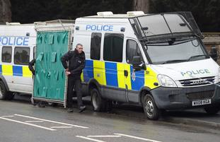 Screens erected outside the London Road cemetery in Salisbury where Sergei Skripal's wife and son were laid to rest.