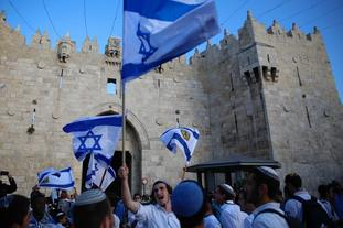 Israelis wave national flags outside the Old City's Damascus Gate. (AP)